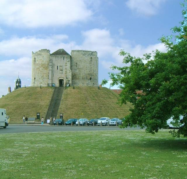 This is a view of Cliffords Tower showing the access stairs. The tower is actually adjacent to a car park.