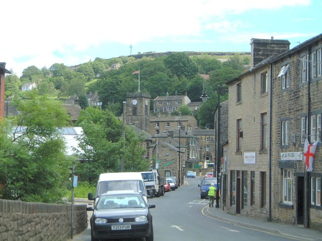 A view looking towards Holmfirth town centre, the world cup football competition was on at the time hence the flag. I believe we were still in with a chance at this time.